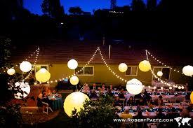 how to string lights across backyard backyard wedding lights