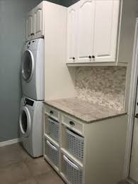 Washer And Dryer Cabinet Solution To A Small Laundry Room Stacked Washer And Dryer