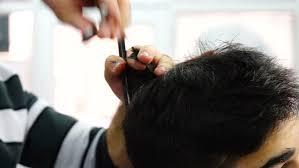 female haircutting videos clipper haircut at barber s female hairdresser shaping men s hair into a