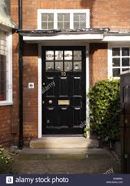 home front door traditional black front door of redbrick house kingsmead uk