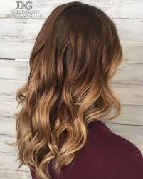 warm balayage with long hair brown to blonde ombre fall hair