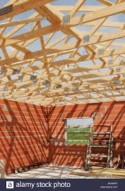 wooden a frame roof truss construction on a small house stock