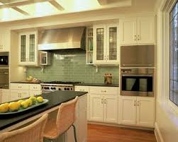 green subway tiles transitional kitchen