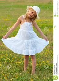 cute little in white dress and hat walking stock photography