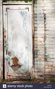 close up view of old wooden door with painting color peeled off