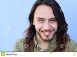 portrait of a young man with cool long hairstyle looking at camera
