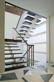 elegant cable railing banister with black gloss acrylic step foot
