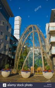 winter garden of a restaurant with turning torso in background in