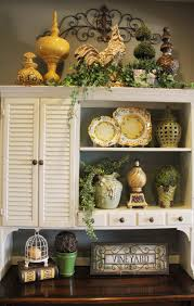kitchen armoire cabinets above cabinet decor greenery wrought iron scroll the placement