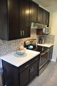 espresso kitchen cabinets with white countertops kitchen interior design