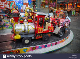 fair ground ride childrens cars track young kids children stock