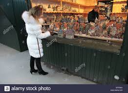 lady looks at christmas ornaments salzburg austria 27 december
