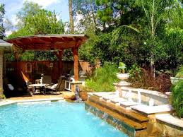 Plants For Pergola by Swimming Pool With Small Waterfall Behind Green Garden Plants For