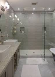 Gray Tile Bathroom Ideas by White Subway Tiles Frame A Gray Marble Herringbone Tiled Shower