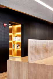 chicago office by those architects has pegboard walls and a