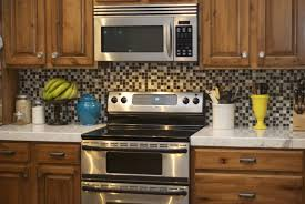 modern backsplash ideas for small kitchen with wooden cabinetry