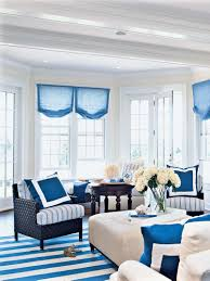 blue living room white printed curtain black and white striped rug