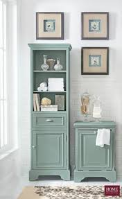 decorate your bathroom with a coordinating linen cabinet and