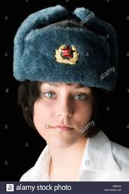 beautiful blue eyed woman in russian ushanka hat with badge of the