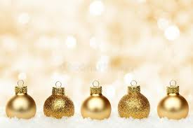 gold background with baubles in snow stock photo image
