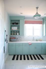 How To Decorate A Laundry Room Decorated And Organized Laundry Room With Color The