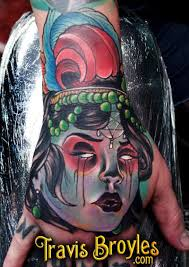 travisbroyles evil lady head hand tattoo feather tattoo pentegram
