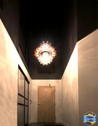 concrete ceiling lighting laqfoil high gloss stretch ceiling in this condo hallway not only