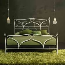 white iron bed frame with high head boars plus curving ornaments