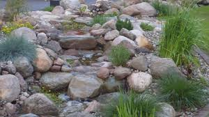 how to build natural garden stream with waterfall light cross path
