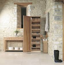 brown unfinished wood tall shoe rack in rustic stone home design