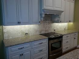 custom kitchen tile backsplash over stove by aaa