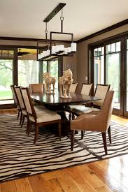 5 rooms featuring a zebra print rug dark wood trim dark wood