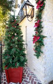 holiday tree planter and bringing christmas to the front porch