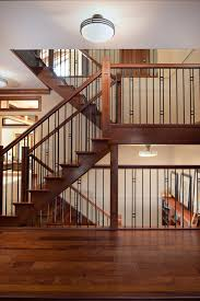 railings for stairs living room rustic with area rug earth tone