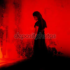 halloween background horror movie black witch mysterious in black dress standing in abandon