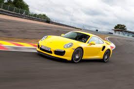 yellow porsche side view 2014 porsche 911 turbo u0026 turbo s first drive