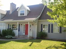 two story home blue exterior well kept landscaping http