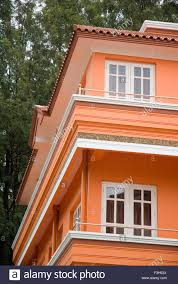 building with bright orange color paint ooty tamil nadu