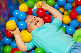 baby with play balls free stock photo domain pictures