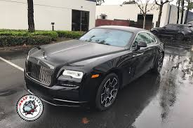 black rolls royce rolls royce wraith top half wrapped in satin black wrap bullys