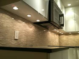 under cabinet puck lighting puck lights microwave fan modern kitchen vancouver by skg