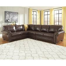 sofa super store signature design by ashley banner 3 piece leather match sectional