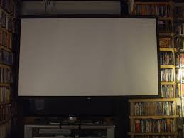 retractable home theater screen world cinema paradise eight reasons why you should dump that lcd