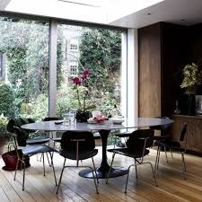eero saarinen oval tulip table black lacquer by rove concepts