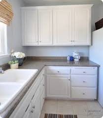 mini kitchen makeover tutorial on painting cabinets white with