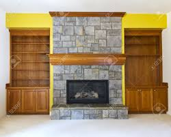 Yellow Accent Wall Yellow Accent Wall With Fireplace And Book Shelves Stock Photo