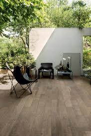 Exterior Tiles For Patios The Wood Effect Of Wooden Tile Shows Graphic Textures Of Solid