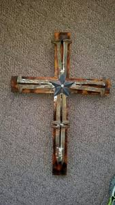 rustic cross made from railroad tie nails twine mounted on