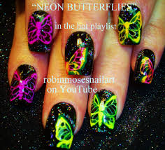 wild purple and blue butterfly design with black shatter nail art