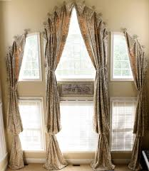 furniture arched window treatments with beige patterned curtains